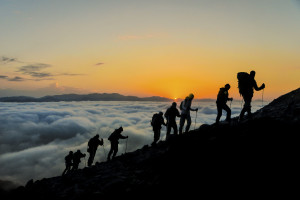 Silhouettes-of-hikers-At-Sunset-000071143375_Large